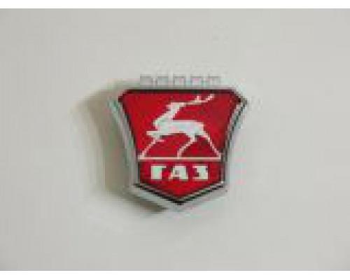 Знак заводской облицовки радиат. ГАЗ-3110,31105 красный